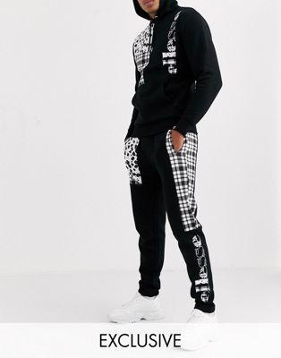ellesse - Tomant - Sorte joggingbukser med patchworkpanel - Kun hos ASOS