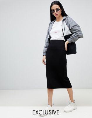 Falda midi de tubo en punto negro de Monki