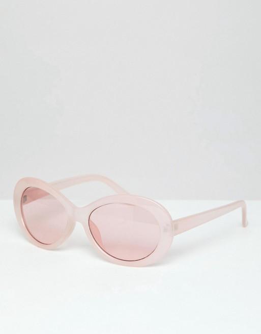 Gafas de sol con montura ovalada en rosa y lentes rosas de ASOS DESIGN