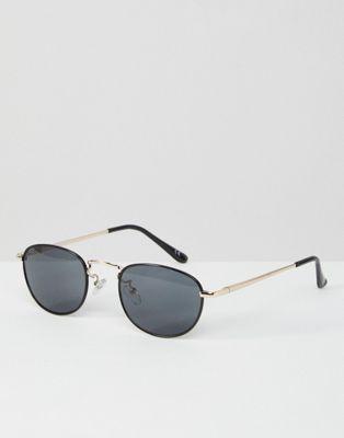 Gafas de sol pequeñas y ovaladas en negro con puente metalizado en plateado 90S de ASOS