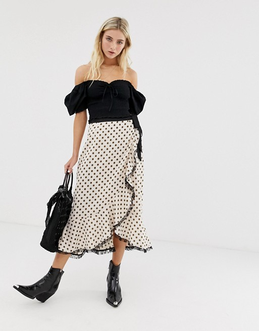 Glamorous wrap front midi skirt with lace trim in floral polka dot