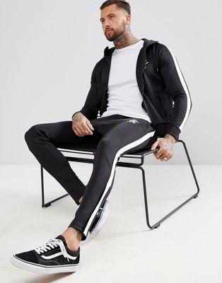Gym King – Enge Polyester-Jogginghose in Schwarz mit Seitenstreifen