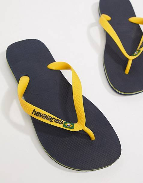 f8115e15e3195 Havaianas Brasil Logo flip flops in navy and yellow