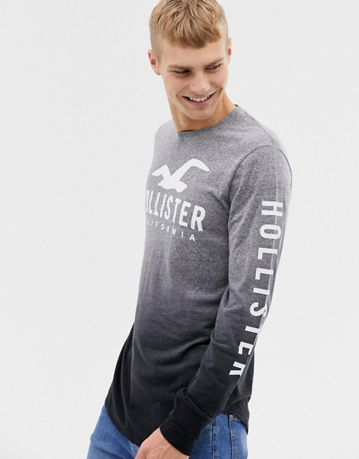 Image 1 of Hollister chest and sleeve logo dip dye long sleeve top in gray marl to black