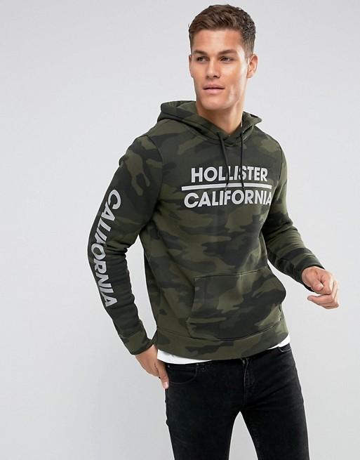 Hollister Sweat à capuche à logo athlétique imprimé Camouflage vert