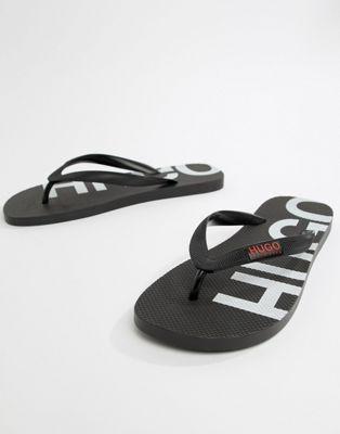 HUGO – Svarta flip flops med omvänd logga