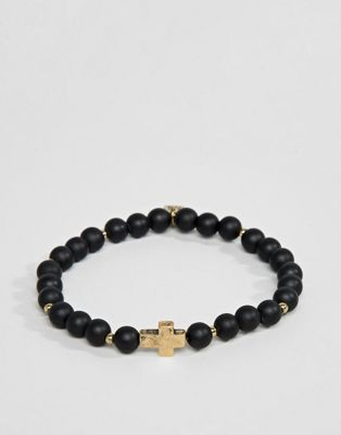 Icon Brand black beaded bracelet with gold cross charm