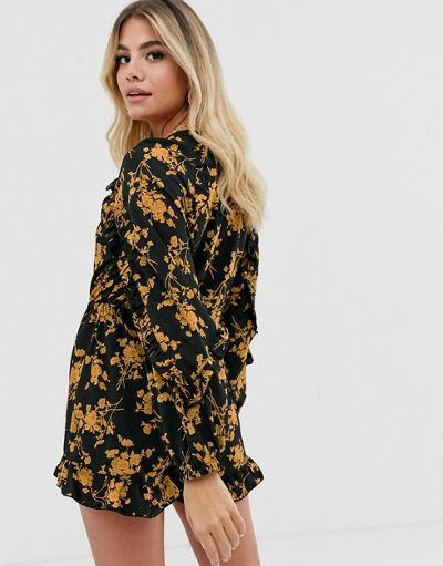 In The Style x Dani Dyer wrap front ruffle playsuit in black floral print
