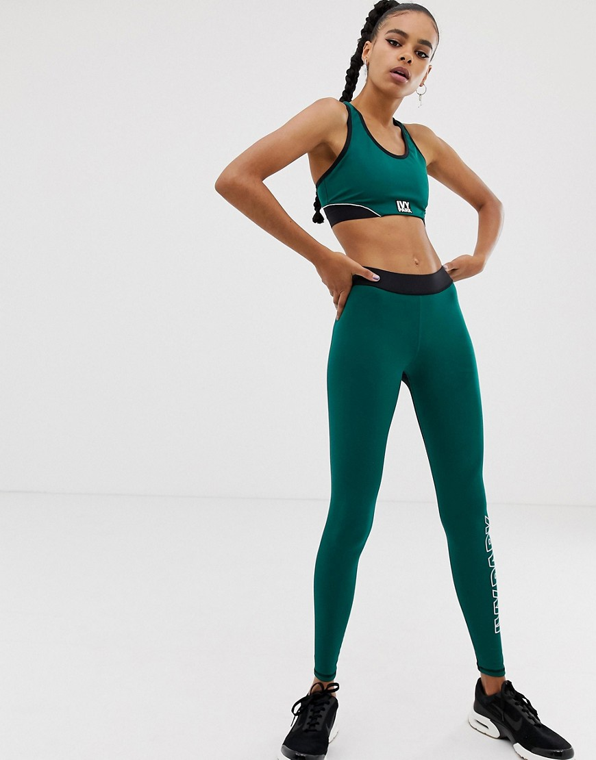 Ivy Park Active Color Block Racerback Bra In Green by Ivy Park