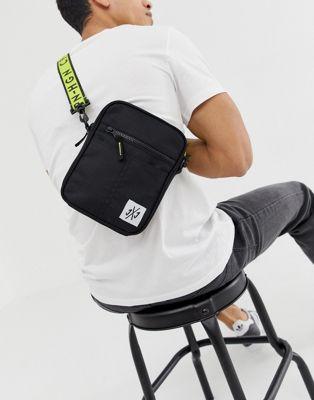 Image 1 of Jack & Jones cross body bag in black with neon contrast strap
