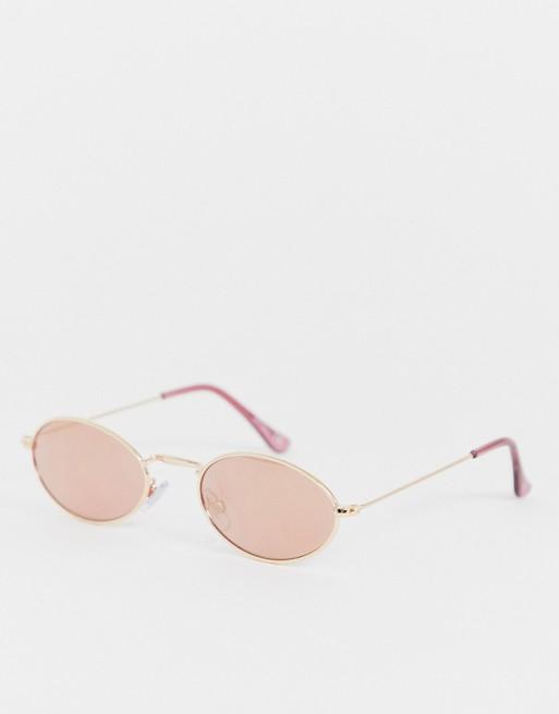Jeepers Peepers - Ronde zonnebril met smal montuur in roze