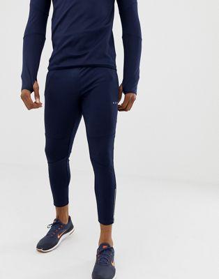 Joggers deportivos muy ajustados en azul marino con cremallera en el puño de ASOS 4505