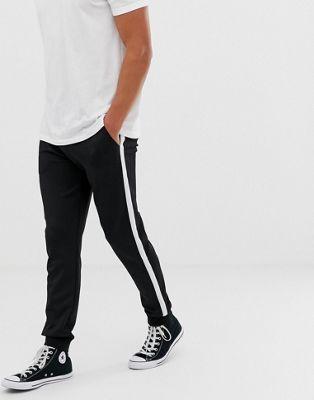 Kiomi - Pantalon de survêtement resserré aux chevilles avec bande sur le côté - Bordeaux