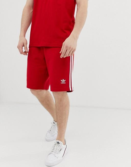 Изображение 1 из Красные шорты с 3 полосками adidas Originals DV1525