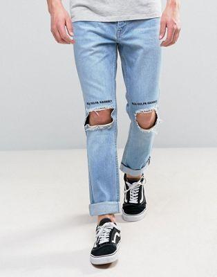 Kubban – Schmale Jeans mit aufgerolltem Saum und aufgerissenen Knien