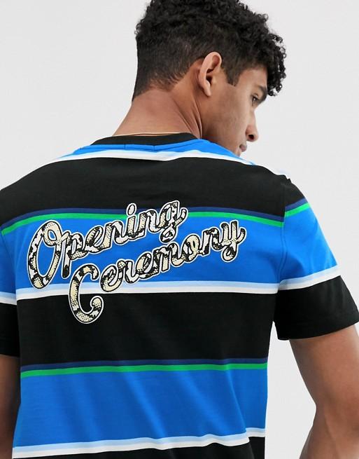 Bild 1 von Lacoste L!VE X Opening Ceremony – Gestreiftes T-Shirt in Blau mit Logo hinten