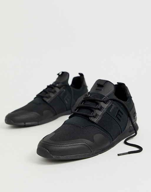 Lacoste Menerva Elite sneakers in triple black