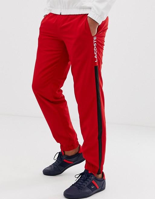 Image 1 of Lacoste side stripe jogging bottoms