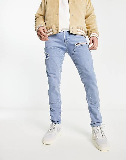 Let forvaskede blå skinny jeans med indsyede paneler fra ASOS DESIGN