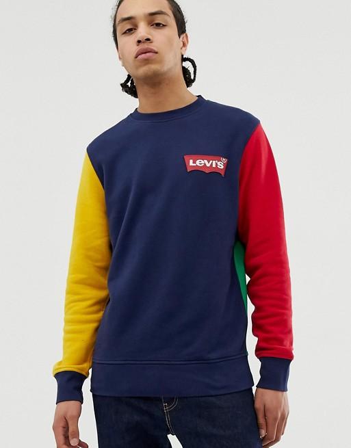 Bild 1 av Levi's – Marinblå, röd och gul sweatshirt med rund halsringning och liten logga