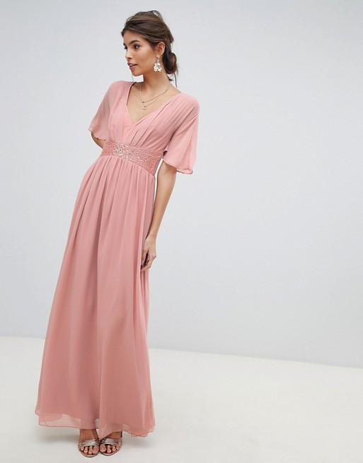 Little Mistress – Sukienka maxi z rozkloszowanymi rękawami, zdobieniem w talii i dekoltem w kształcie litery V