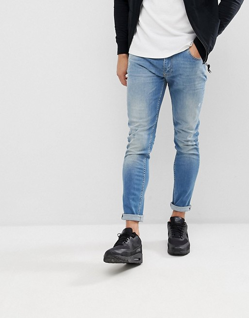Image 1 of Love Moschino Skinny Fit Jeans In Midwash Blue With Distressing