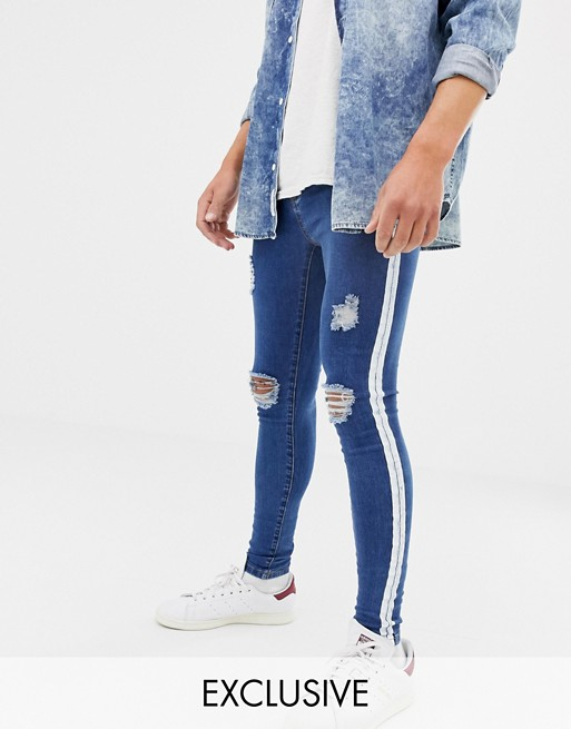 43acfc7c5 Mauvais muscle fit jeans with distressing and side stripe | ASOS