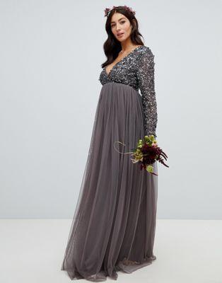 Bild 1 av Maya Maternity – Mörkgrå, långärmad maxiklänning med omlott framtill, fina paljetter och tyllkjol