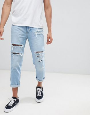 Mennace Slim Fit Tapered Crop Jean With Extreme Rips In Light Blue