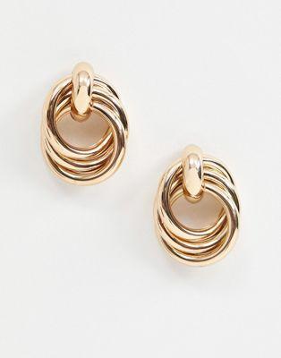 Monki earrings in gold