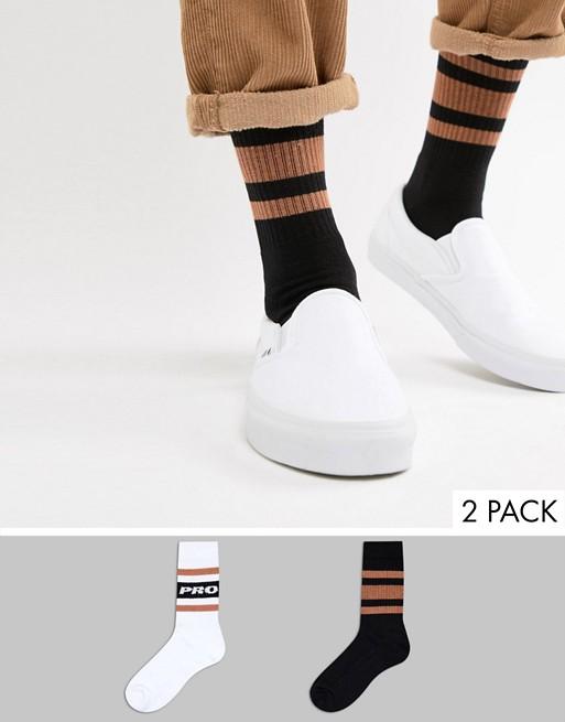 Imagen 1 de Multi-pack de 2 pares de calcetines deportivos con eslogan pro y rayas mostaza de ASOS DESIGN, ahorra