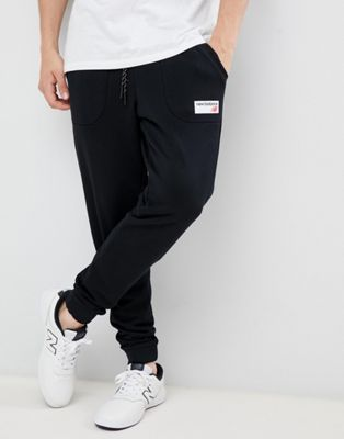 New Balance small logo joggers in black MP83515_BK