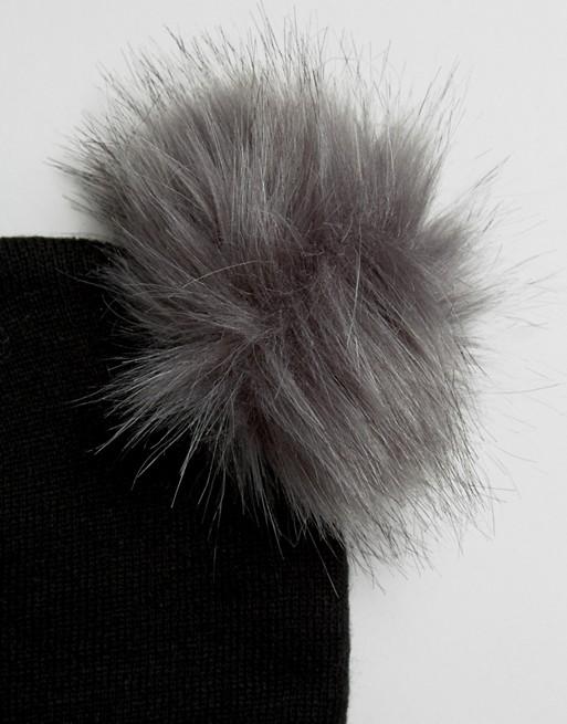 b6577fec0d7 New Look - Bonnet avec double pompon en fausse fourrure