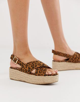 Image 1 of New Look suedette cross strap flatform in animal print
