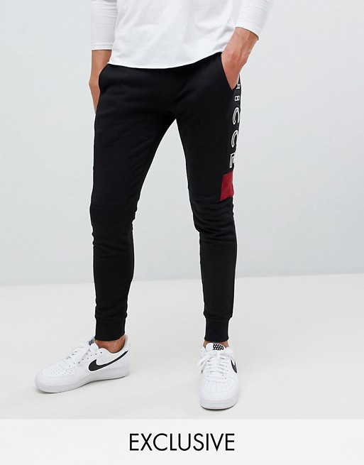 Image 1 of Nicce skinny joggers in black with side logo exclusive to ASOS