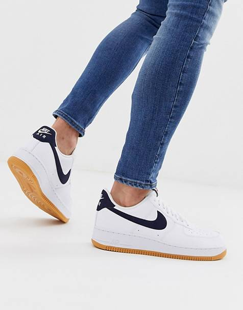 Nike Air Force 1 sneakers with navy swoosh and gum sole
