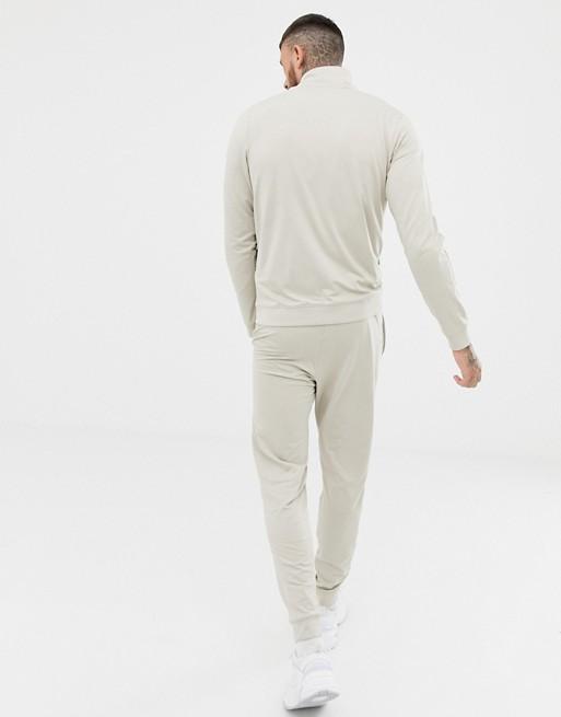 Nike – Gewebtes Trainingsanzug-Set in Beige, 928109-221