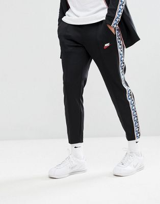 Nike Joggers With Taped Side Stripe In Regular Fit In Black AJ2297-010
