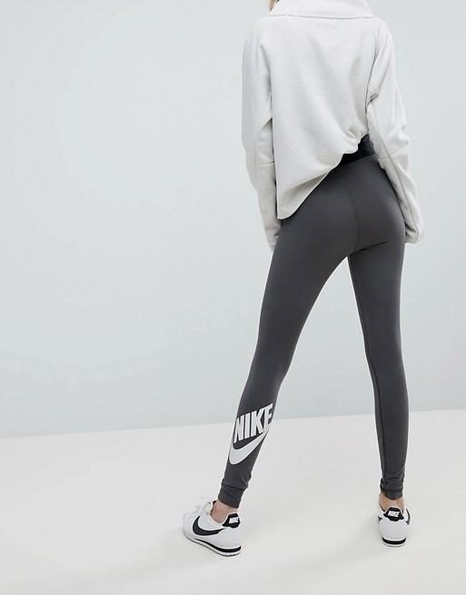 buy popular af892 76d0d Nike Leg A See High Waisted Leggings In Dark Grey   ASOS
