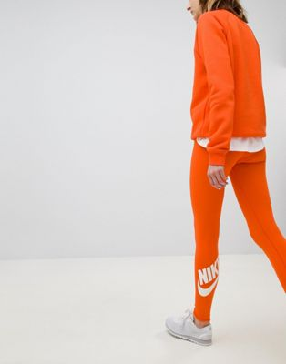 Nike Legasee Logo Leggings In Orange