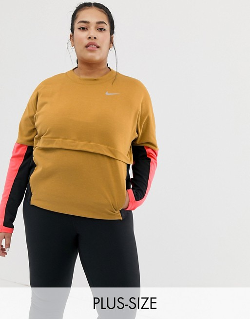 Image 1 of Nike Plus Running Thermasphere Long Sleeve Top In Gold And Pink