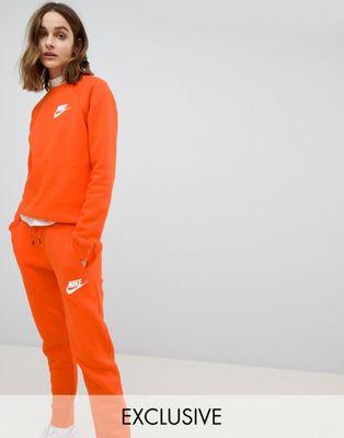 Nike - Rally - Joggers arancioni - In esclusiva per ASOS