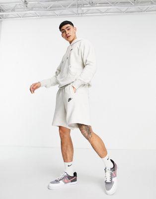 Nike Revival shorts in off white - ASOS Price Checker
