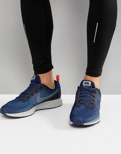 newest 834ef 70924 Image 1 of Nike Running Air Zoom Pegasus 34 shield trainers in blue  907327-400