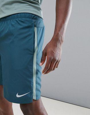 Bild 1 von Nike Running – Dry Challenger – Grüne Shorts, 9 Zoll, 908800-328