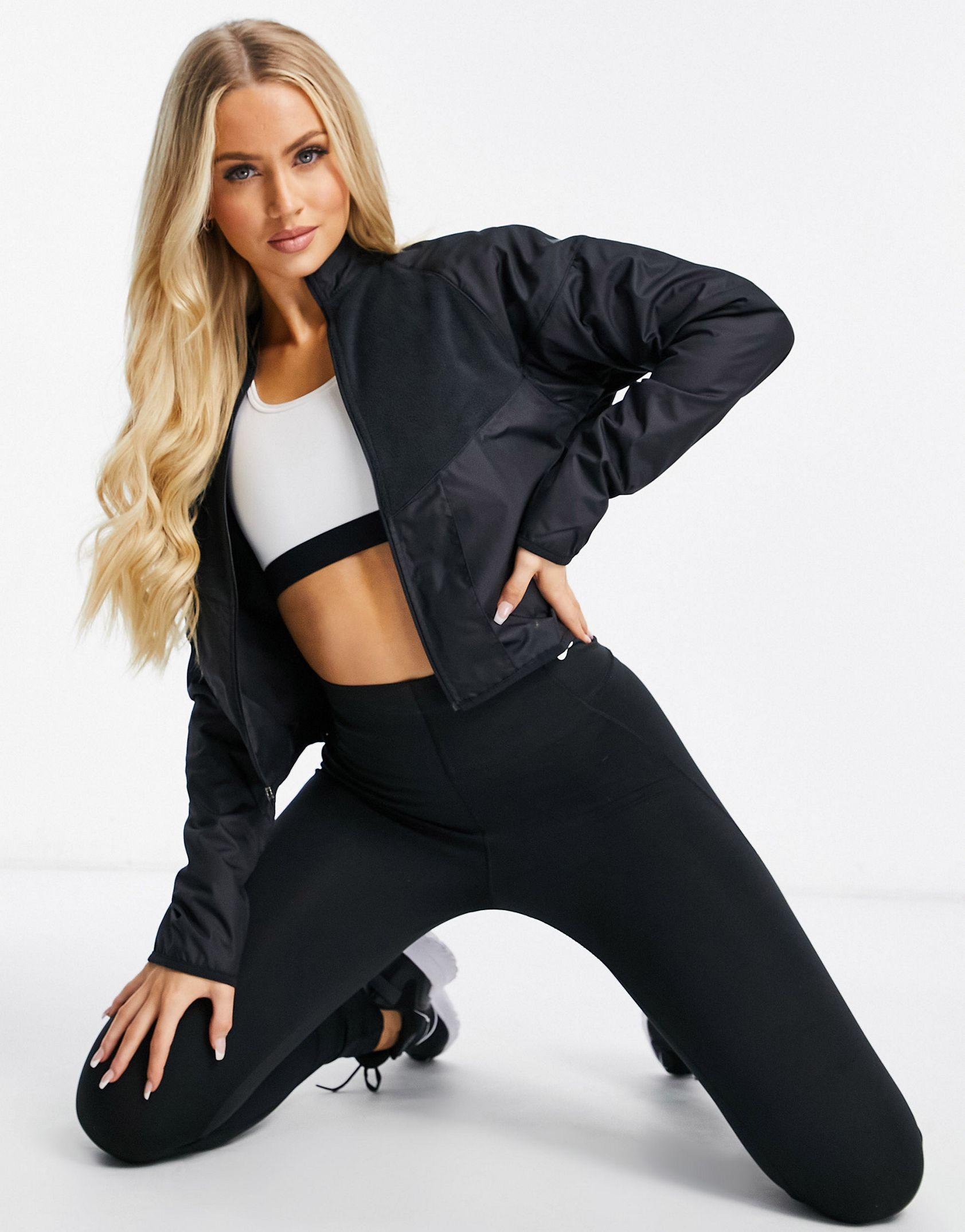 Nike Running Run Division jacket in black -  Price Checker