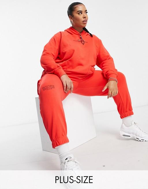 Nike Swoosh Plus fleece joggers in red