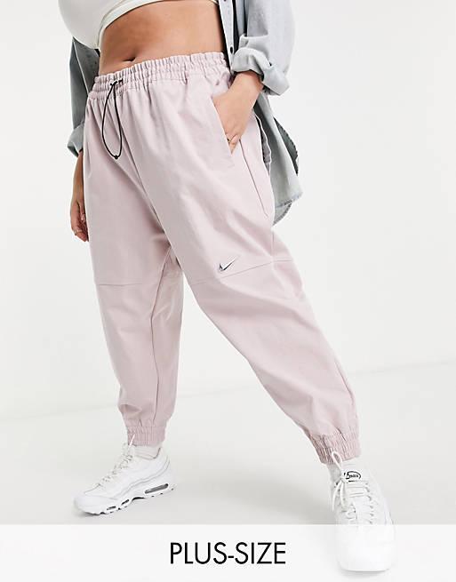 Nike Swoosh Plus woven bottoms in light pink