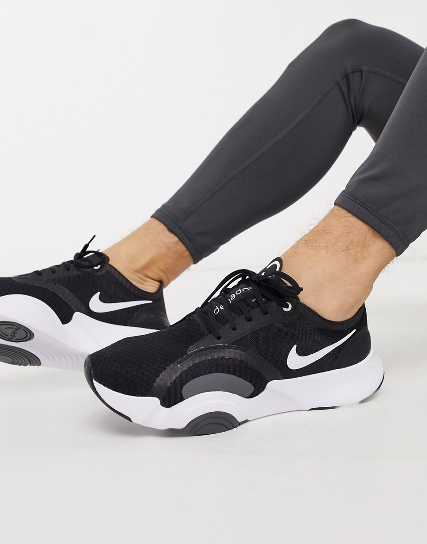 Sneakers by Nike This item is excluded from promo Ideal for self-guided workouts or training on-the-go Lace-up fastening Sock-like cuff Branded tongue Nike Swoosh logo Chunky sole Moulded tread