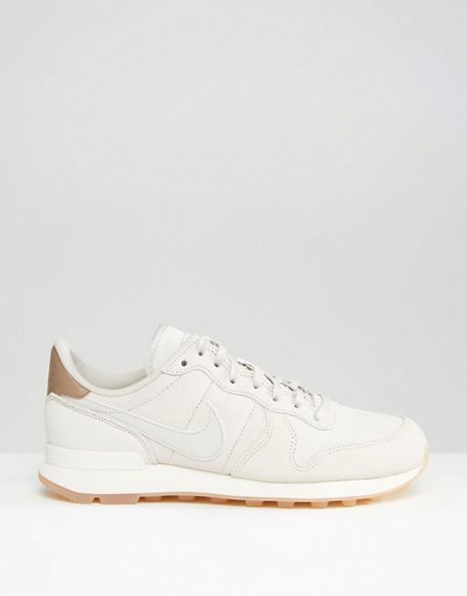 separation shoes 5c0ca e6455 ... top quality shop nike nike white gold internationalist premium sneakers  d345b 098ff e319d 132d8